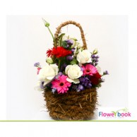 White roses 8 nos and mix gerberas 8 in basket CON008
